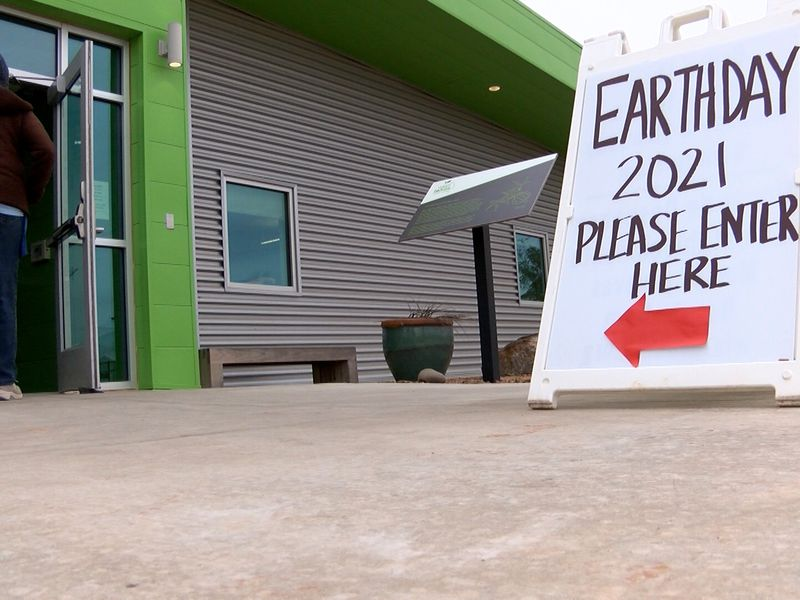 Visitors walk into the West Texas Food Bank in Midland for the annual Earth Day event.