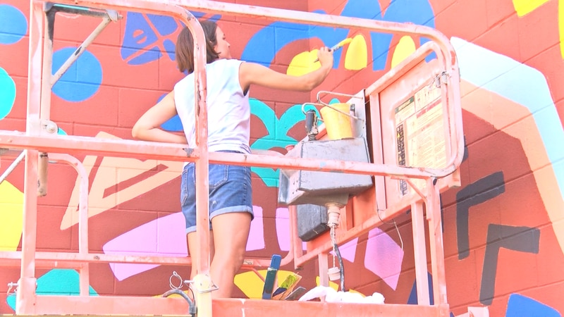 Mari Pohlman works on the Museum of the Southwest's new mural.