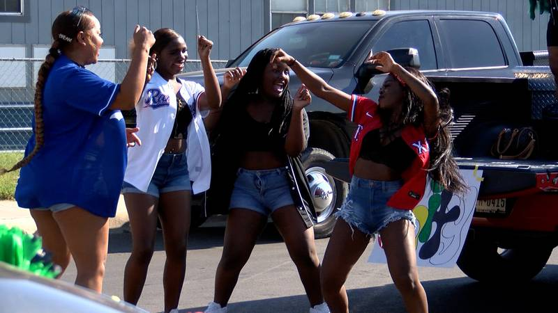 Girls dance to hip-hop legend Kris Kross while taking part in the Midland Juneteenth Parade.
