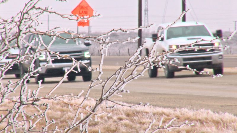 Cars drive along icy roads north of Odessa