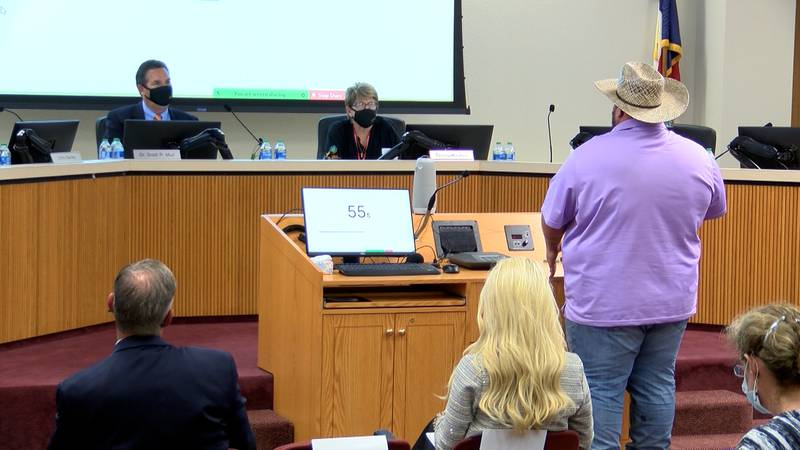 A man speaks in front of the Ector County ISD board.