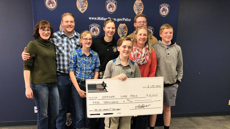 The nonprofit gave $10,000 to a Midland Police officer who was hurt in a wreck last year.