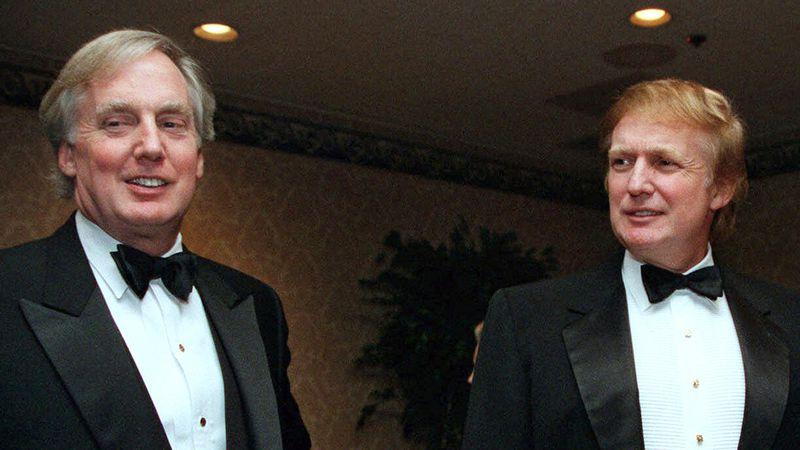 FILE - In this Nov. 3, 1999 file photo, Robert Trump, left, joins then real estate developer...