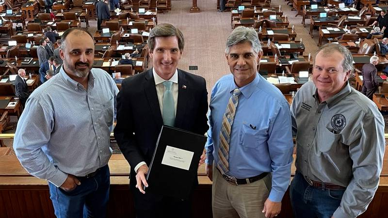 Texas State Rep. Brooks Landgraf (middle left) stands with members of the Andrews county...