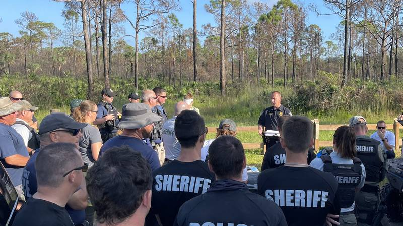 Searchers gather at Carlton Reserve Friday to resume the search for Brian Laundrie.
