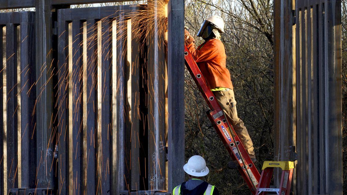 FILE - Crews construct a section of border wall in San Bernardino National Wildlife Refuge,...