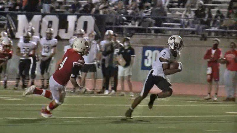 Permian's Shy Stephens Deary avoids Odessa's Jesse Cervantes for one of his five touchdowns...