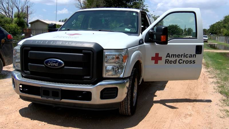Red Cross volunteers visit a flooded home in Midland County.