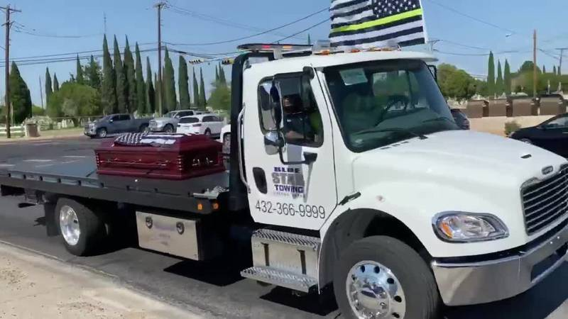Tow truck drivers hold procession for fellow driver