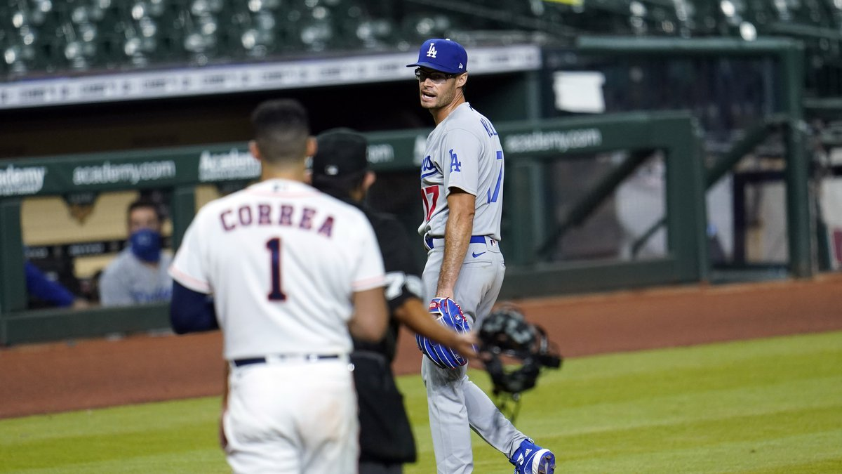 Los Angeles Dodgers relief pitcher Joe Kelly (17) talks toward Houston Astros' Carlos Correa...