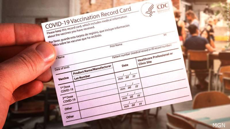 A COVID-19 Vaccination Record Card.