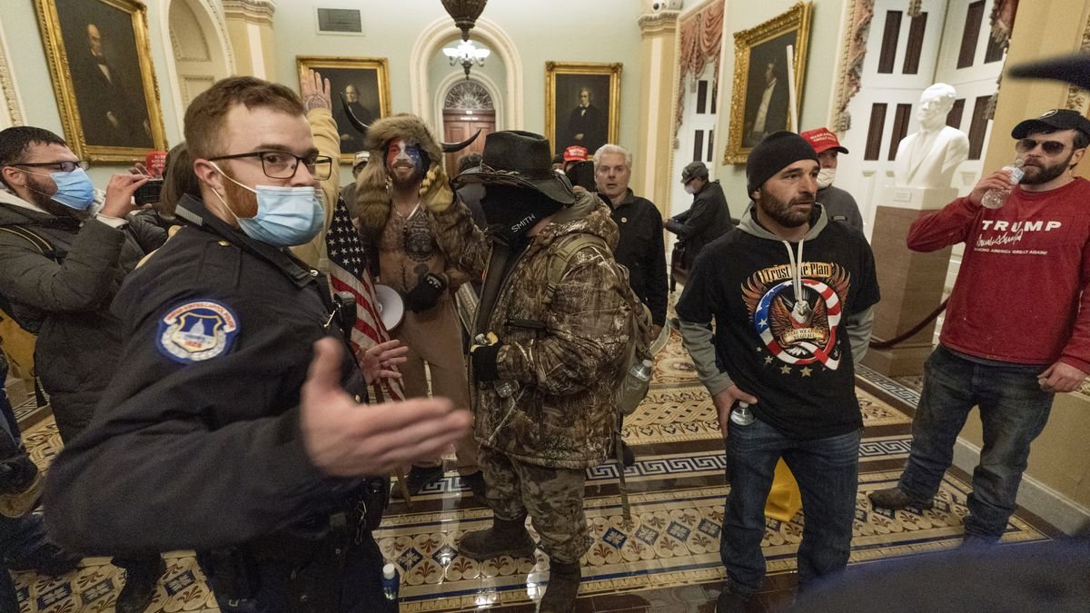 Supporter of President Donald Trump are confronted by Capitol Police officers outside the...