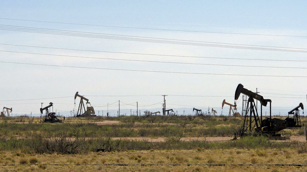 FILE - In this April 9, 2014, file photo, oil rigs stand in the Loco Hills field on U.S....