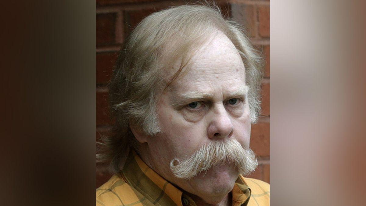 FILE - In this June 10, 2013 file photo, University of Alabama fan Harvey Updyke departs the...