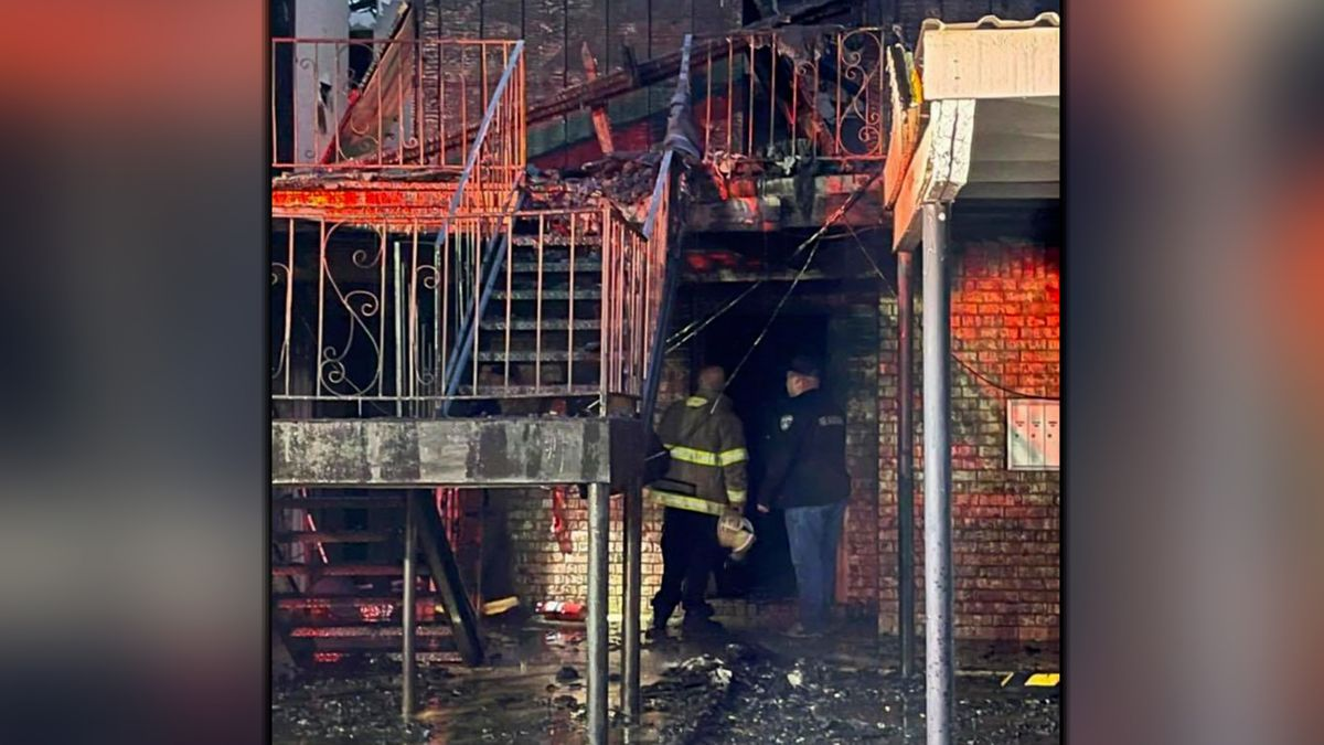 Firefighters look through the rubble of Ponderosa Apartments early Sunday morning.