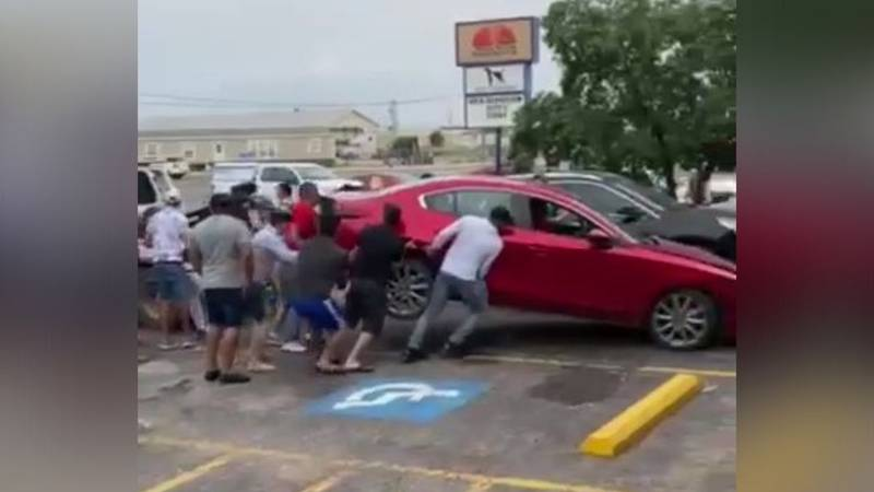 A group of protesters lifed a car off of a tow truck on Sunday,