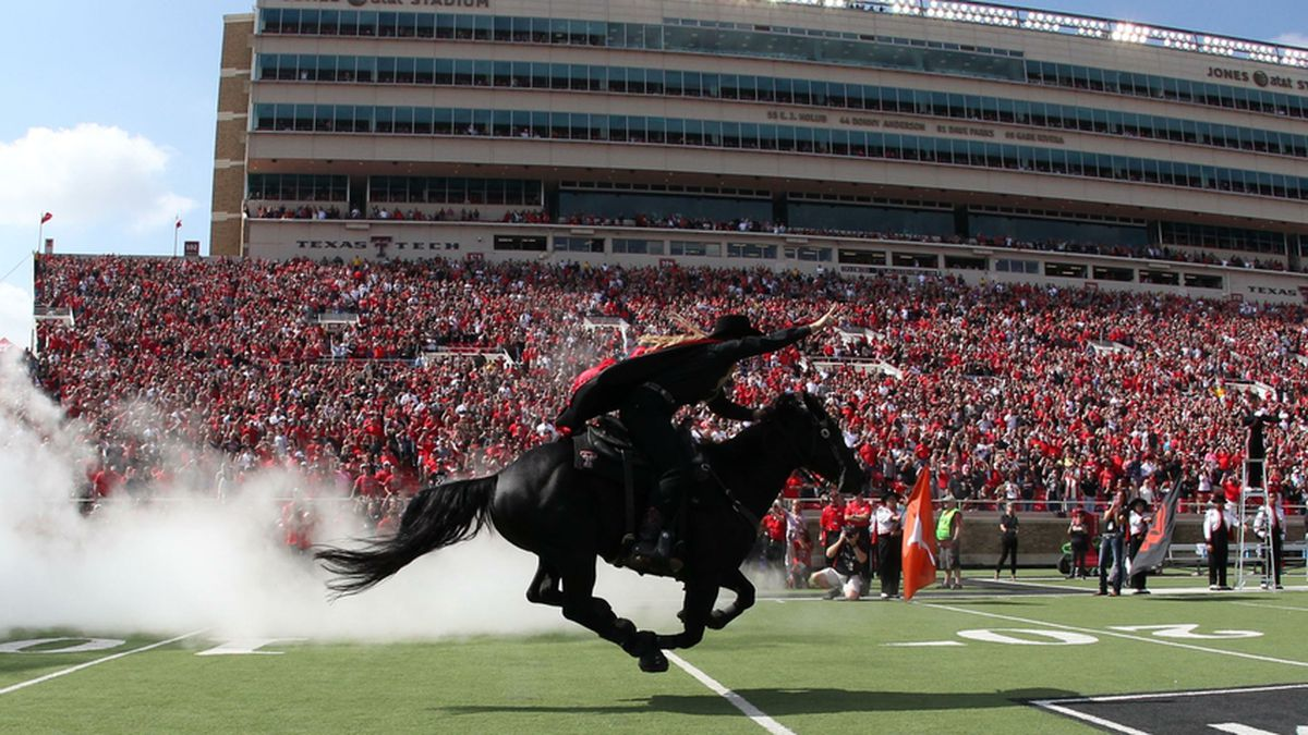 Oct 10, 2015; Lubbock, TX, USA; The Texas Tech Red Raiders Masked Rider enters the field before...