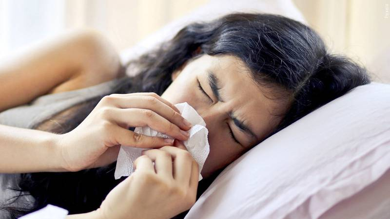 A woman dealing with allergies.