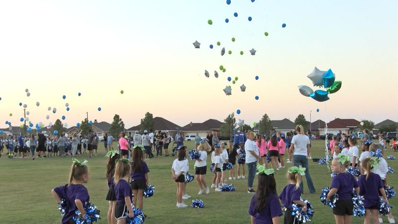 Compass Academy athletes and parents took time to remember Kenny and Melissa Comstock