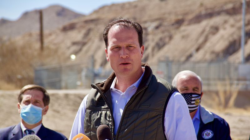 Congressman August Pfluger speaks outside of a border facility in El Paso on Monday, March 15.