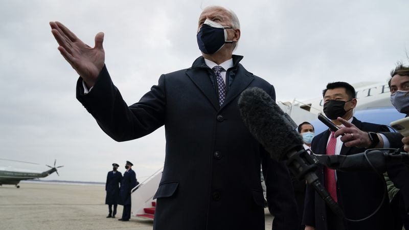 President Joe Biden speaks to member of the media after exiting Air Force One, Friday, Feb. 19,...