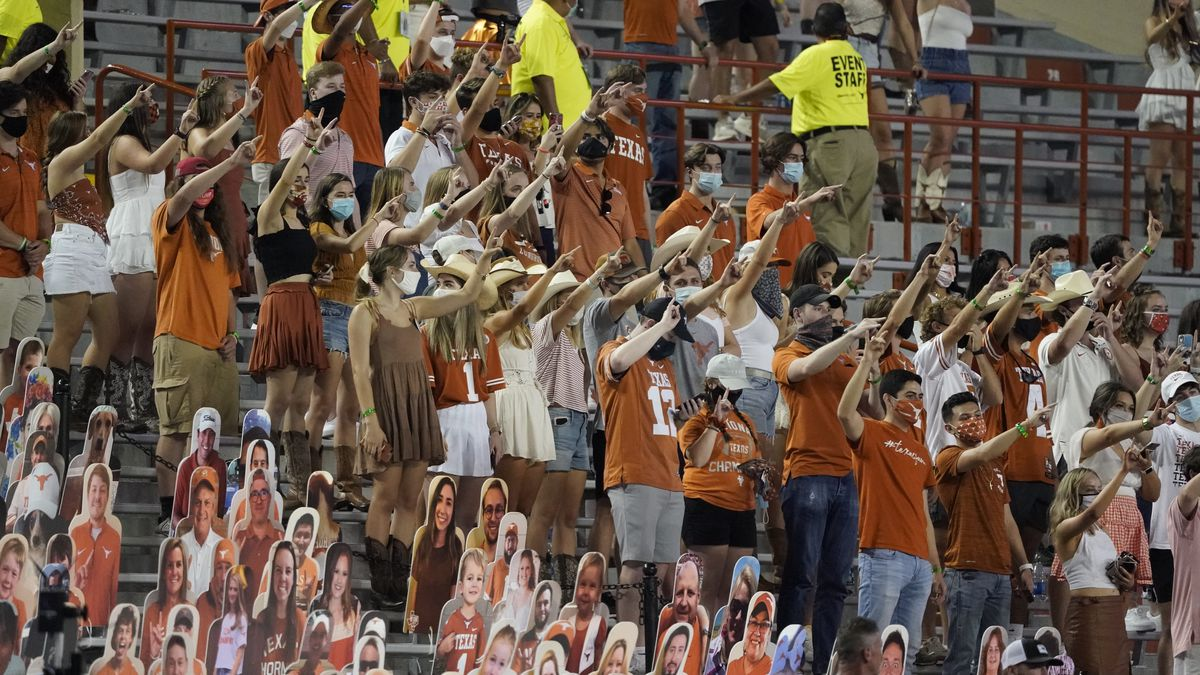 """FILE - In this Saturday, Sept. 12, 2020, file photo, fans join in singing """"The Eyes of Texas""""..."""