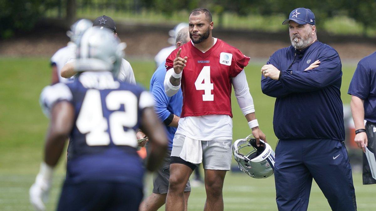 Dallas Cowboys quarterback Dak Prescott (4) stands with head coach Mike McCarthy as they watch...