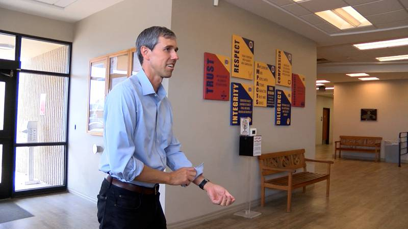 Beto O'Rourke greets bystanders as he enters the Midland County Elections Office