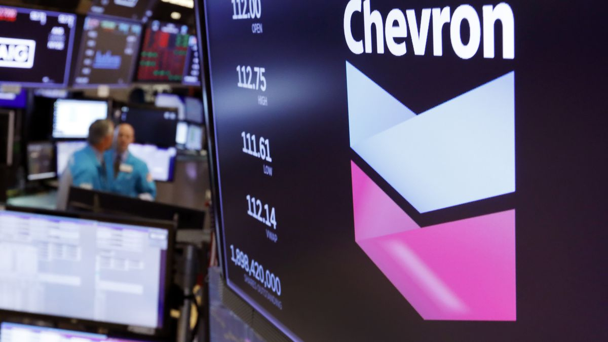 FILE - This Oct. 8, 2019, file photo the logo for Chevron appears above a trading post on the...