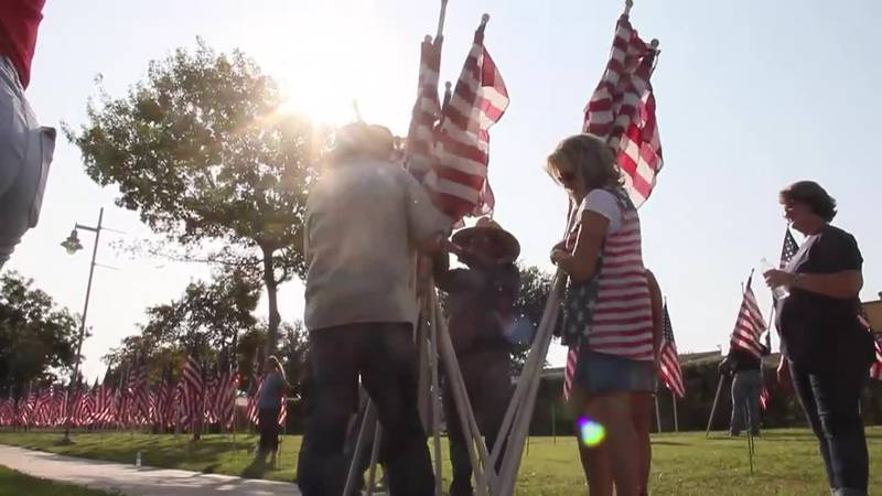 Flags placed at Memorial Gardens Park