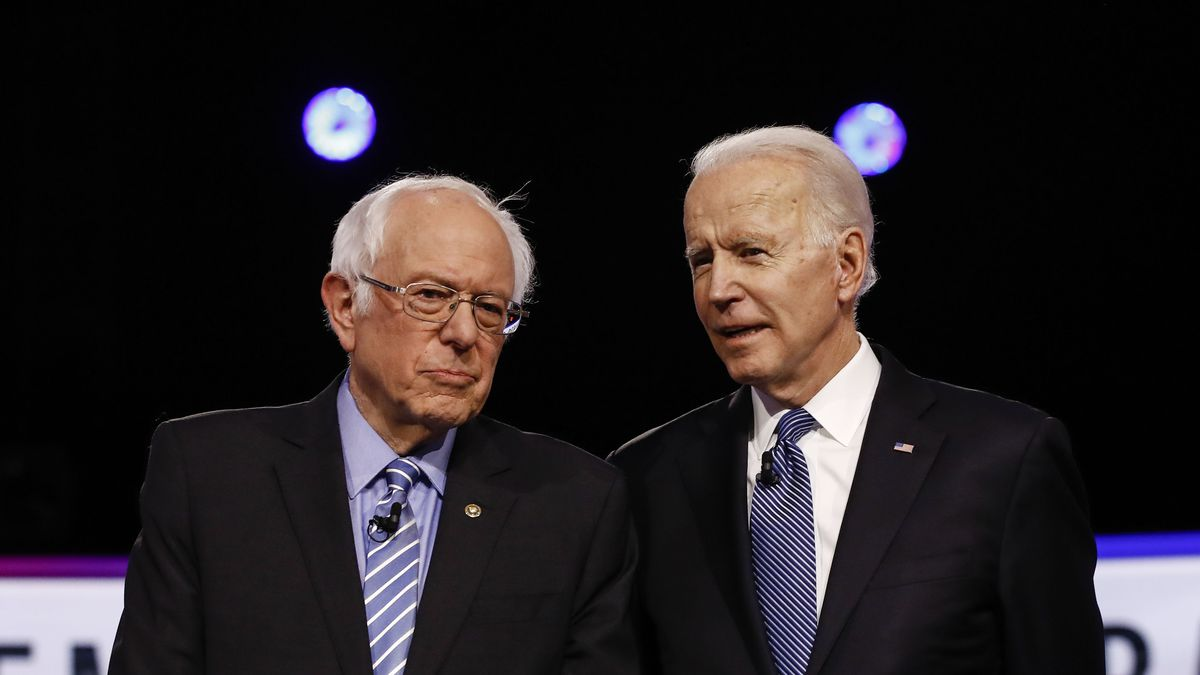From left, Democratic presidential candidates, Sen. Bernie Sanders, I-Vt., former Vice President Joe Biden, talks before a Democratic presidential primary debate, Tuesday, Feb. 25, 2020, in Charleston, S.C.