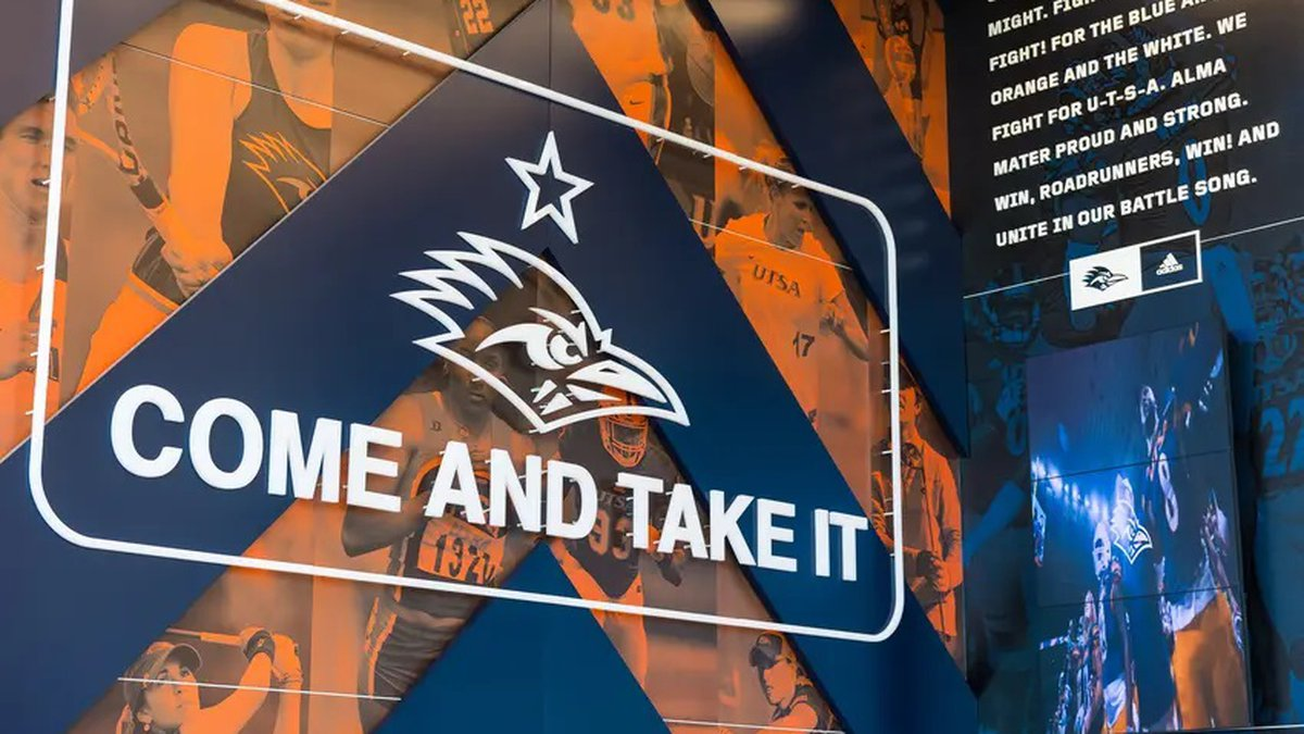 """The """"Come and Take It"""" motto on a wall at the University of Texas at San Antonio's campus."""