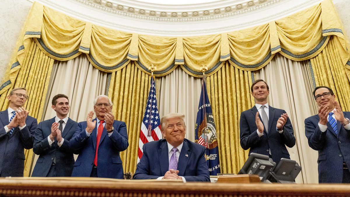 President Donald Trump, accompanied by From left, U.S. special envoy for Iran Brian Hook, Avraham Berkowitz, Assistant to the President and Special Representative for International Negotiations, U.S. Ambassador to Israel David Friedman, President Donald Trump's White House senior adviser Jared Kushner, and Treasury Secretary Steven Mnuchin, smiles in the Oval Office at the White House, Wednesday, Aug. 12, 2020, in Washington. Trump said on Thursday that the United Arab Emirates and Israel have agreed to establish full diplomatic ties as part of a deal to halt the annexation of occupied land sought by the Palestinians for their future state.