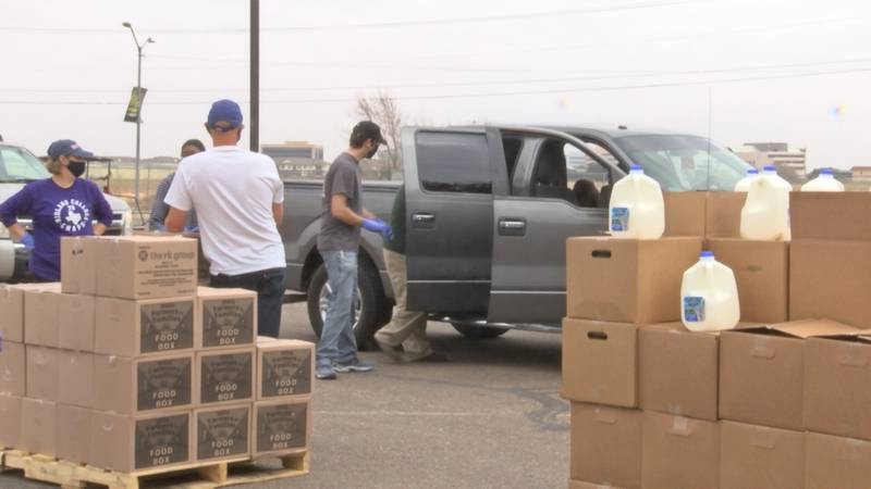 Volunteers at today's food distribution got to see firsthand the need that the Midland...