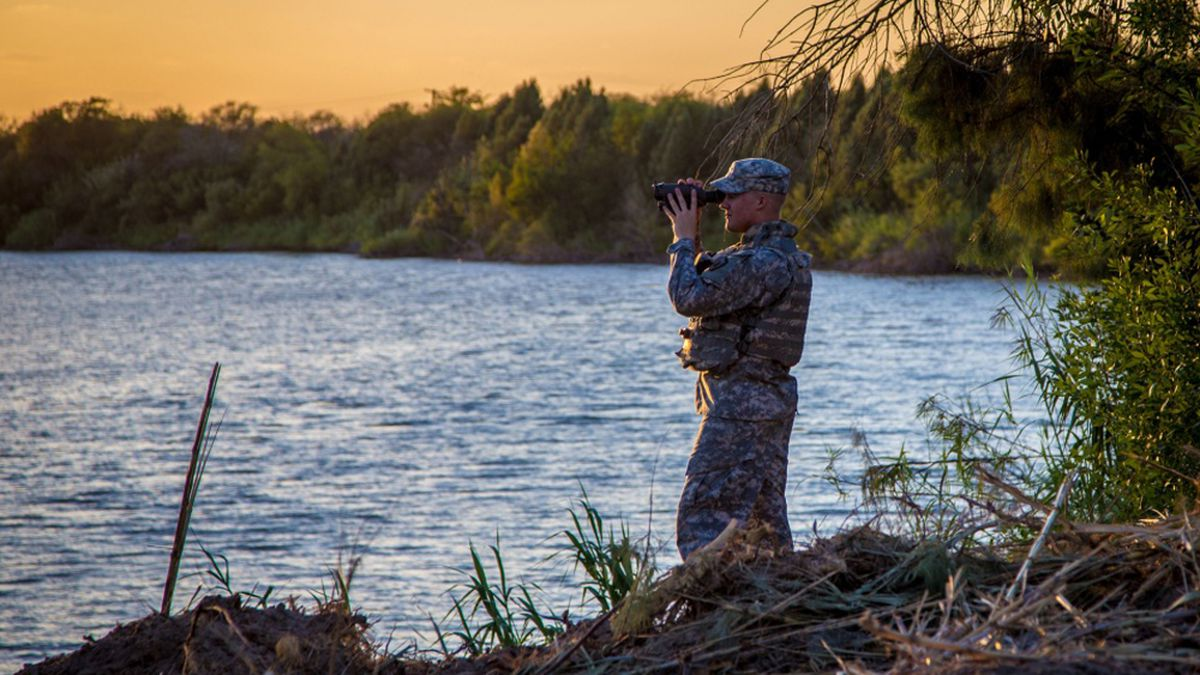 A Texas Army National Guard Soldier observes a section of the Rio Grande River, along the Texas-Mexico border. (U.S. Army National Guard photo by Maj. Randall Stillinger/file)