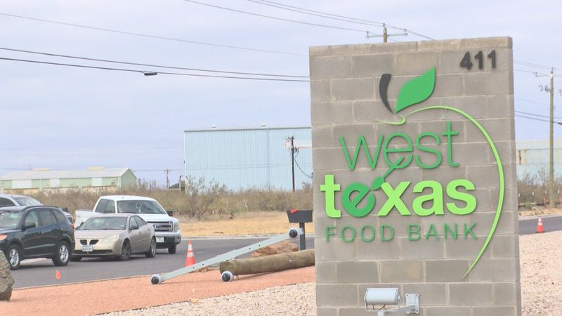 Line of cars at the West Texas Food Bank was exceptionally long, hundreds looked for a little...