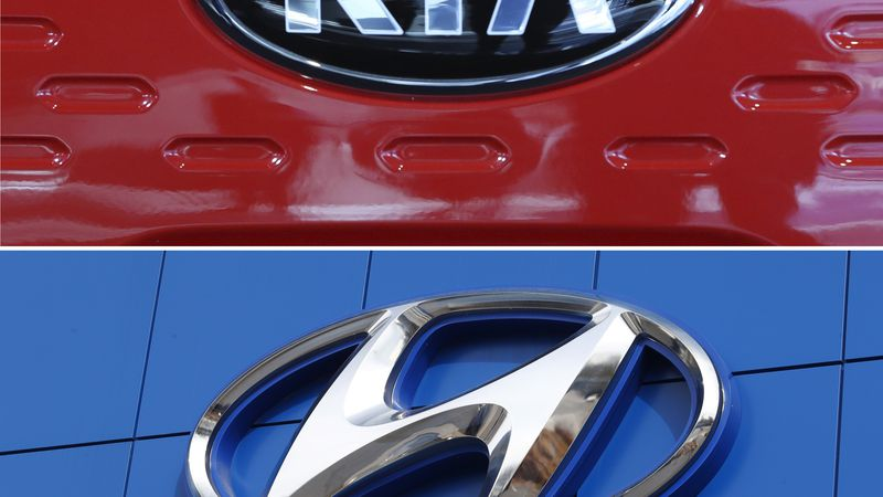 FILE- This combination of file photos shows the logo of Kia Motors during an unveiling ceremony...