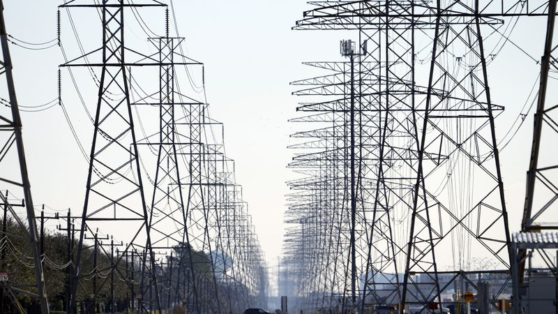 FILE - This Tuesday, Feb. 16, 2021, file photo shows power lines in Houston. When an unusually...