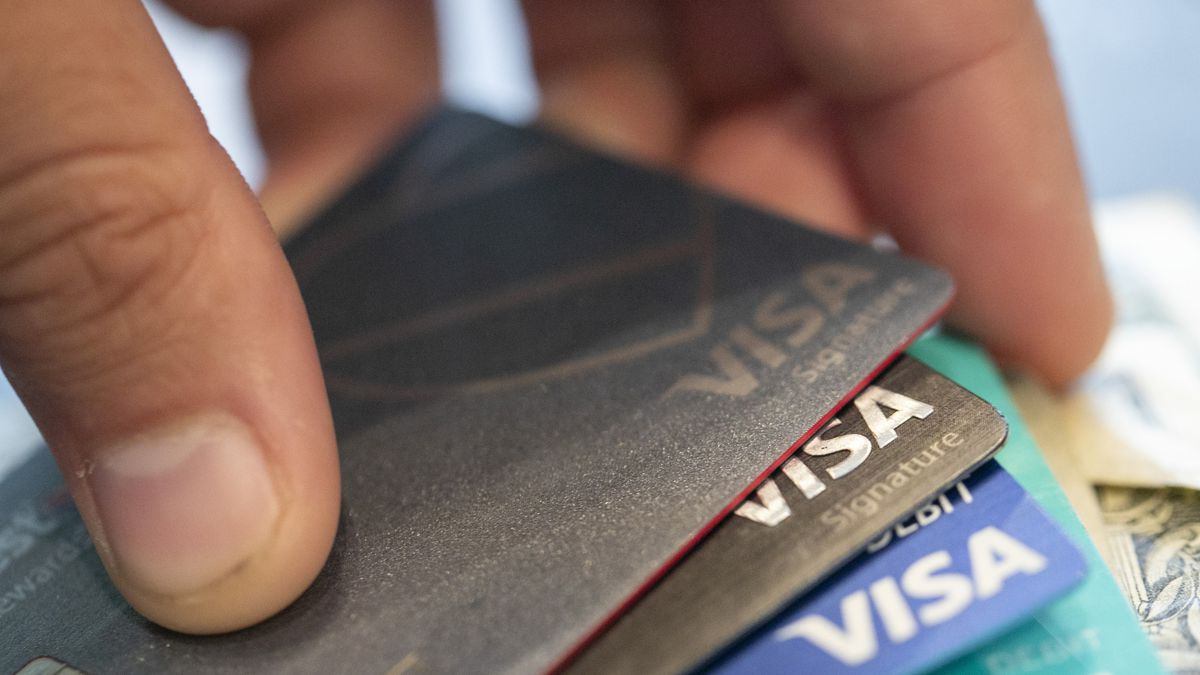 This Aug. 11, 2019 file photo shows Visa credit cards in New Orleans. U.S. consumers reduced their borrowing for a third straight month in May 2020 as the millions of jobs lost because of the coronavirus pandemic made households less eager to take on new debt. The Federal Reserve reported Wednesday, July 8, 2020 that consumer borrowing declined by $18.3 billion in May, a drop of 5.3%.