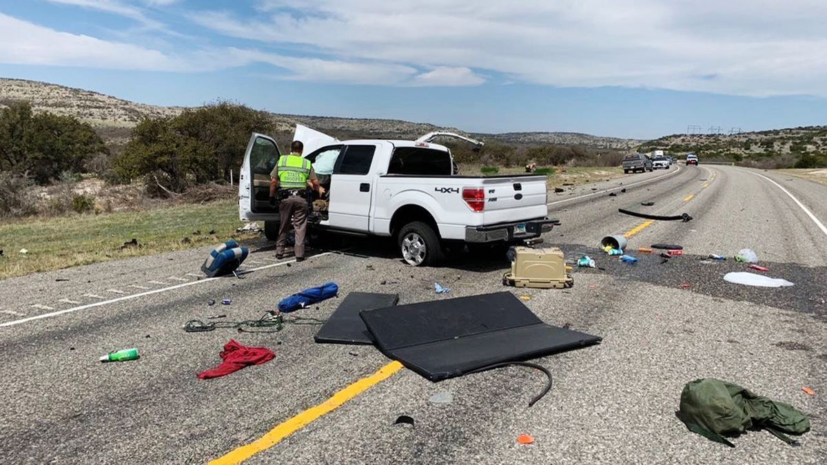 Debris is strewn across a road near the border city of Del Rio, Texas after a collision Monday,...