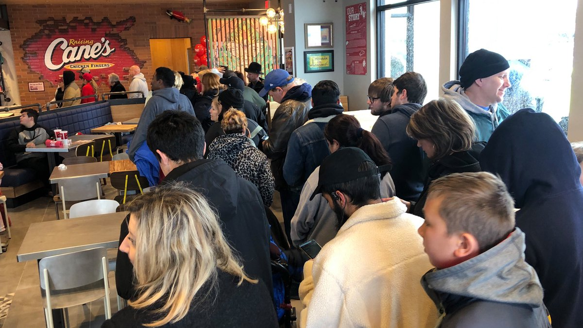 A large crowd waited outside in the cold for the opening of Raising Cane's in Midland on...
