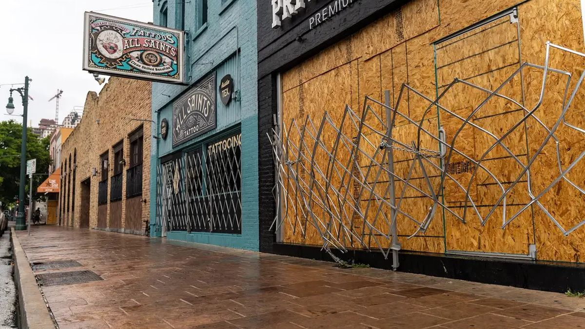 Workers boarded up bars on Sixth Street in Austin after Gov. Greg Abbott closed bars in Texas for the second time in three months because of the COVID-19 pandemic.