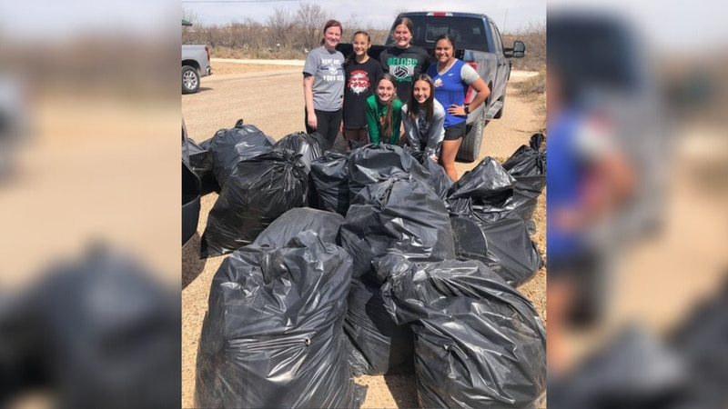 Members of the Monahans volleyball club found a way to give back during their time off.