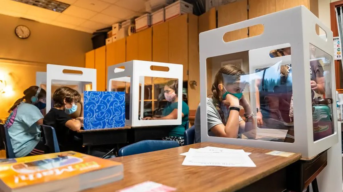 Fifth graders at Jacob's Well Elementary School in Wimberley worked from behind desktop...