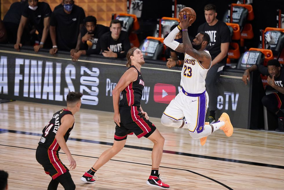 Los Angeles Lakers' LeBron James (23) takes a shot over Miami Heat's Kelly Olynyk (9) during the second half in Game 6 of basketball's NBA Finals Sunday, Oct. 11, 2020, in Lake Buena Vista, Fla.