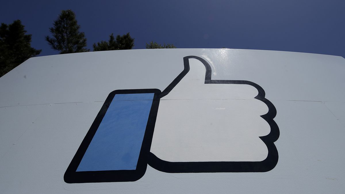 """This April 25, 2019 file photo shows the thumbs-up """"Like"""" logo on a sign at Facebook headquarters in Menlo Park, Calif."""