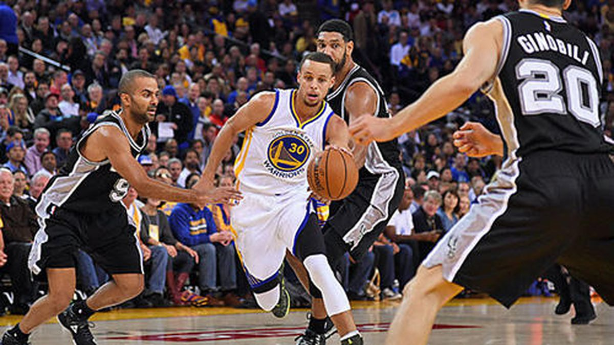 Nov 11, 2014; Oakland, CA, USA; Golden State Warriors guard Stephen Curry (30) dribbles the basketball against San Antonio Spurs guard Tony Parker (9), forward Tim Duncan (21, center) and guard Manu Ginobili (20) during the first quarter at Oracle Arena. The Spurs defeated the Warriors 113-100. Mandatory Credit: Kyle Terada-USA TODAY Sports