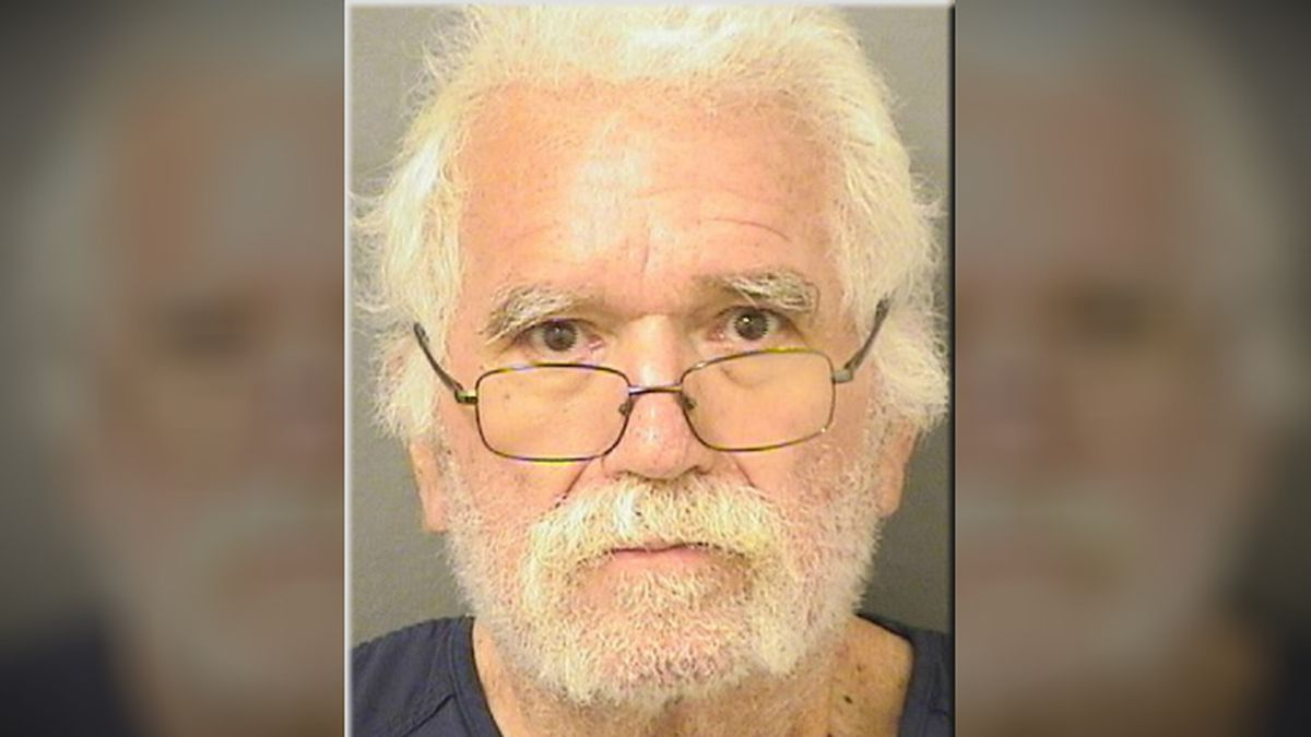 """A 73-year-old Florida man wore a """"Make America Great Again"""" shirt when he took $1,100 from a Wells Fargo on Monday, deputies said. (Source: Palm Beach County Jail)"""