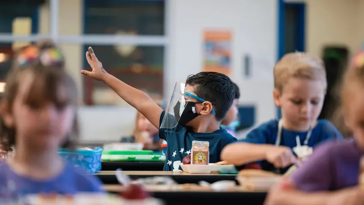 A student wearing a mask and face shield eats lunch at Blanco Vista Elementary School in San...