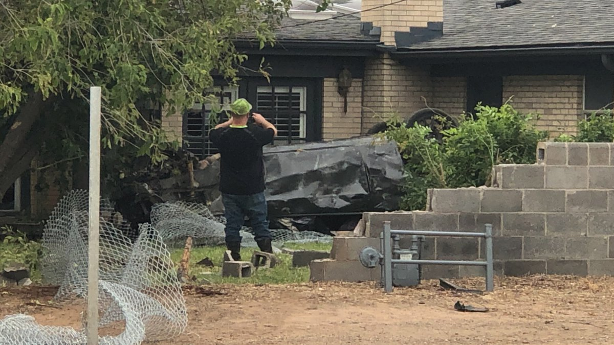 The driver was involved in two wrecks, eventually flipping into a backyard near Burnet...